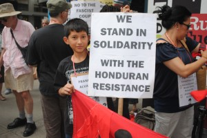 young boy solidarity sign, NYC
