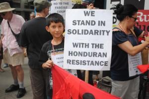 young boy solidarity sign, NYC